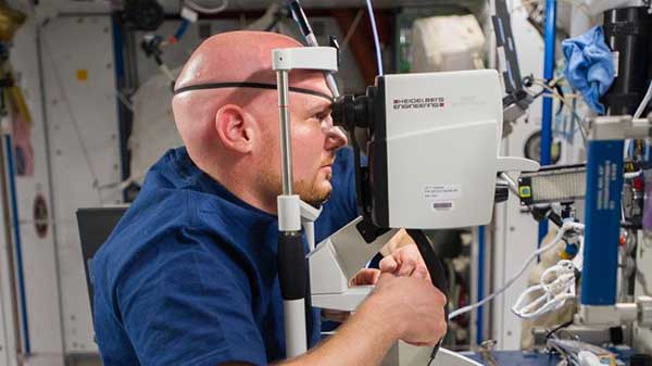 An astronaut on board the ISS having his eye examined with SPECTRALIS.
